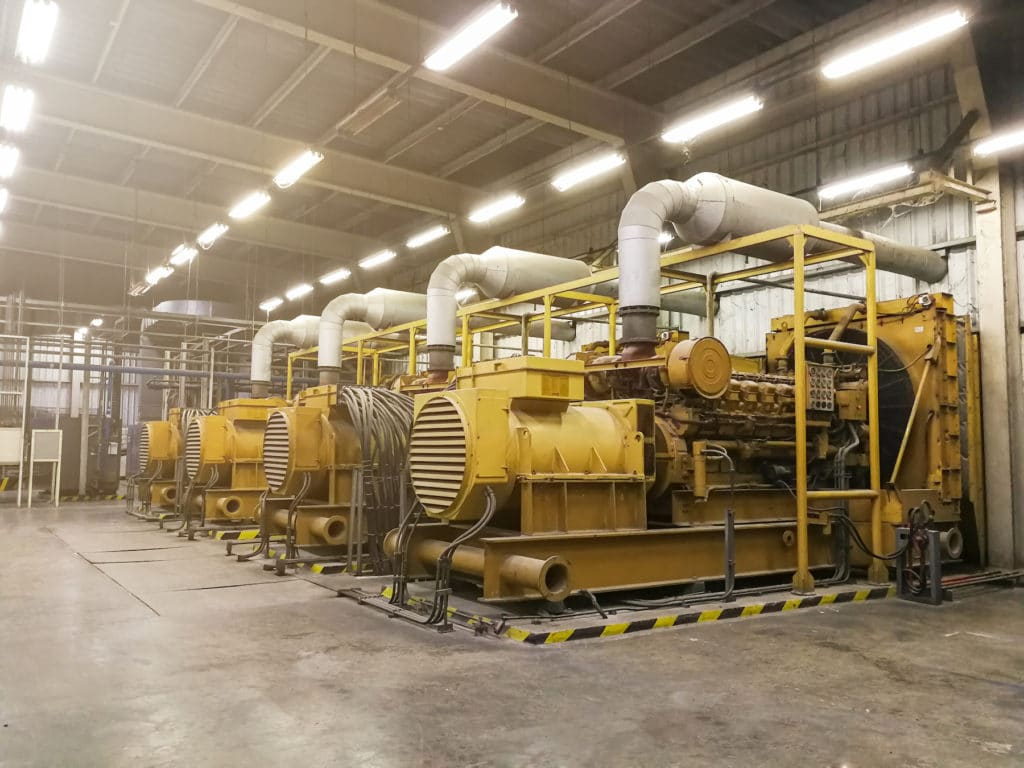 A very large electric diesel generator in factory for emergency,equipment plant modern technology industrial