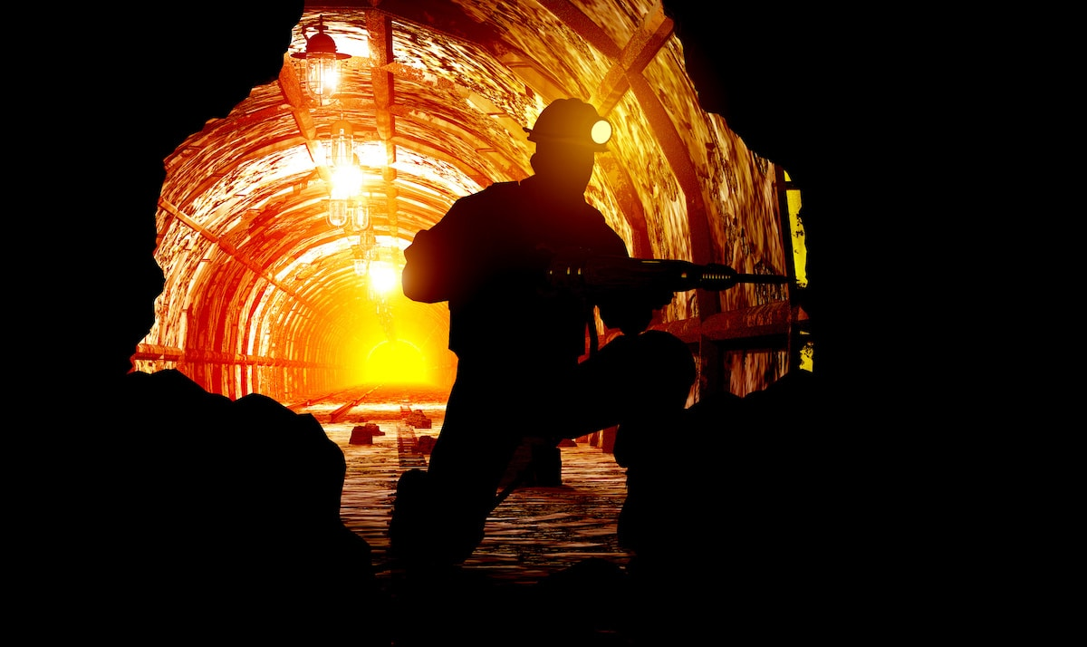 Silhouettes of worker in the mine